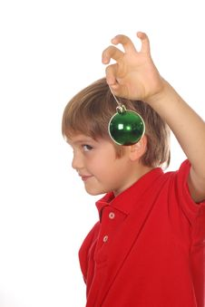 Free Child Holding Ornament Focus On Ball Stock Images - 3714044