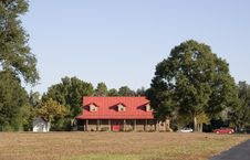 Farmhouse With Red Roof Stock Photography
