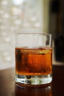 Free Glass Of Whisky With An Ice Royalty Free Stock Photo - 3715235