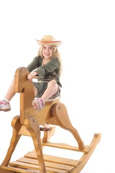 Free Little Girl On Rocking Horse Stock Image - 3716341