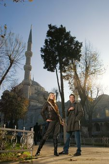 Couple In Front Of Mosque Stock Photography