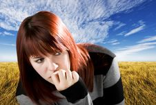 Free Pensive Redhead Girl Biting Nail Stock Photography - 3718702