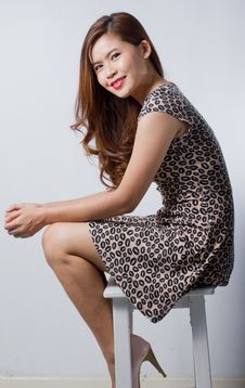 Free Asian Woman In Dress Sitting On Stool Stock Images - 37110364