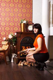 Free Young Beautiful Woman Sits Near The Fireplace Stock Photo - 37182740