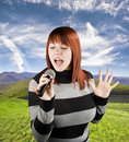 Free Redhead Girl Singing Karaoke On Microphone Stock Photo - 3727300