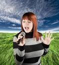 Free Redhead Girl Singing Karaoke On Microphone Royalty Free Stock Photography - 3728617