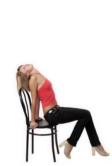 Free Young Woman Sitting On A Chair Royalty Free Stock Photography - 3720257