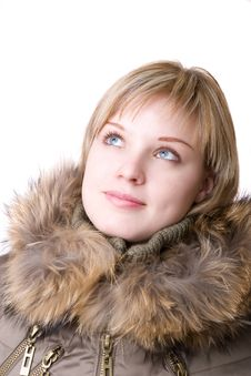Thoughtful Girl In A Jacket With A Collar Of Fur Royalty Free Stock Photography