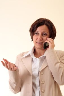 Free White Businesswoman With Handy, Talking Royalty Free Stock Image - 3723976