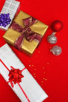 Christmas Presents On Red Royalty Free Stock Image