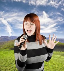 Free Redhead Girl Singing Karaoke On Microphone Stock Photo - 3727300