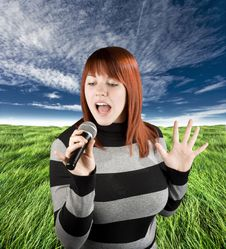 Free Redhead Girl Singing Karaoke On Microphone Royalty Free Stock Photography - 3728617