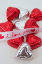 Free I Love You Ribbon Across Candy Hearts Royalty Free Stock Images - 37246319