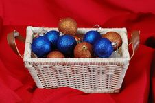 Basket With Christmas Decorations Stock Images