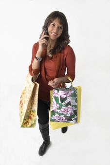 Free Woman With Bags And Cellular Phone Stock Photography - 3734962