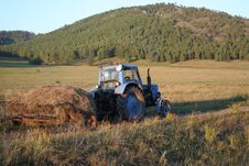 Tractor Transporting Hay Royalty Free Stock Images