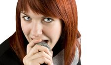 Free Girl Singing Karaoke On Microphone Royalty Free Stock Photography - 3737007