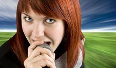 Girl Singing Karaoke On Microphone Stock Photography
