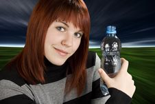 Free Redhead Girl Holding Water Bottle Royalty Free Stock Image - 3737166