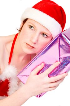 Christmas Faerie Guessing Her Present Stock Image
