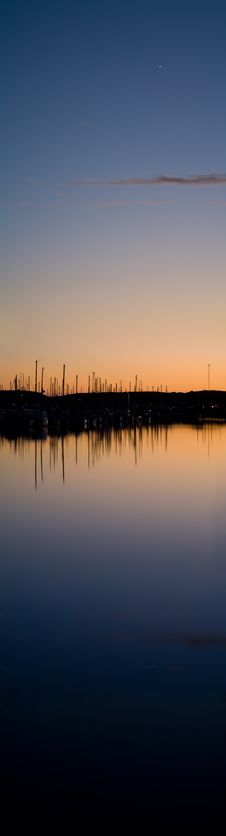 Boats In Harbor At Sunset With Bright Star Stock Photography