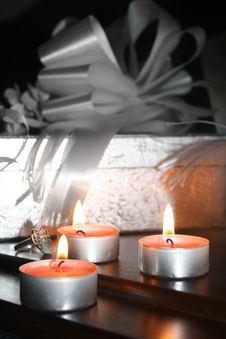 Three Candles, Silver Box And Decorative Bows Stock Photos