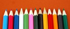 Mixture Of  Colour Pencil. On A Brown Background Royalty Free Stock Image