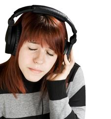 Pensive Girl Listening To Music Royalty Free Stock Images