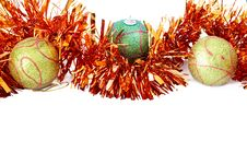 Three Christmas Baubles With Bright Orange Tinsel Royalty Free Stock Photography