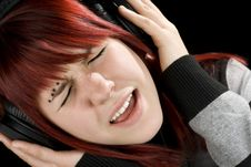 Free Girl Holding Headphones And Singing Royalty Free Stock Photography - 3758077