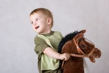 Free Boy Sitting On A Toy Horse Stock Photos - 3758463