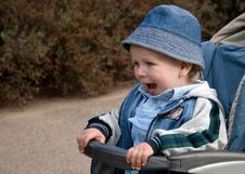 Child Riding In A Baby Carriage Royalty Free Stock Photo