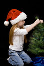 Free Girl Trims Christmas Tree Royalty Free Stock Photography - 3766547