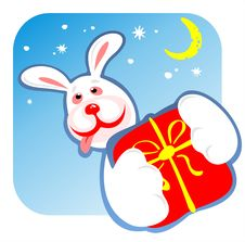 Cheerful Rabbit And Gift Royalty Free Stock Photos
