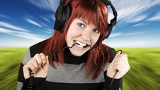 Free Girl Biting Headphone Cable Stock Photos - 3761643