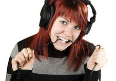 Free Girl Biting Headphone Cable Royalty Free Stock Photo - 3761645