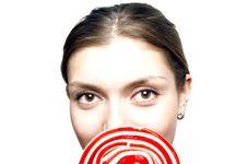 Girl Holding Lollipop Royalty Free Stock Photos