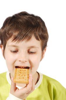 Kid Eating Dollar Cookies Stock Photos