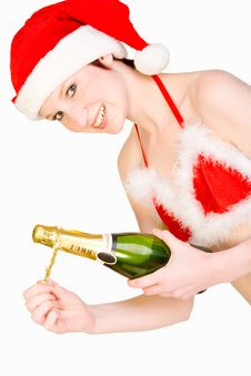 Free Christmas Girl Is Holding A Bottle Of Champagne Stock Photos - 3769663