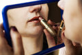 Free Woman Paints Lips With Lipstick Before A Mirror Stock Photo - 37681950