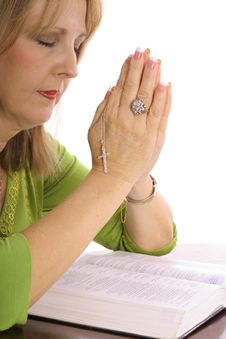 Free Woman Praying Over The Bible With Rhinestone Cross Stock Photo - 3774050