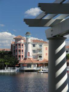 Free Vacation Resort Bldgs Lighthouse & Lake 1 Royalty Free Stock Image - 3775026