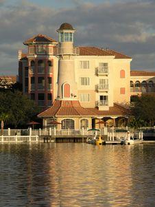 Free Vacation Resort Bldgs Lighthouse & Lake Sunset Stock Photography - 3775042