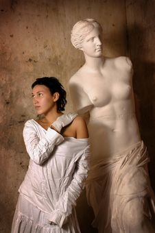 The Girl With An Antique Statue Stock Image