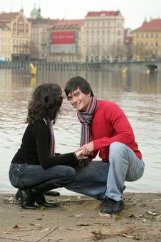Free Happy Couple Near The River Royalty Free Stock Image - 3779006