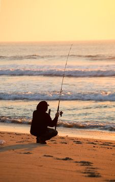 Free Sihouletted Fishing At Sunrise Royalty Free Stock Images - 3781939