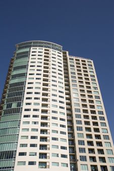 Condo Tower Against Blue Stock Photography
