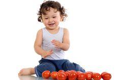 Free Child With Tomato. Stock Photos - 3787913