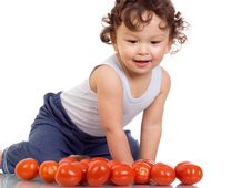 Free Child With Tomato. Royalty Free Stock Image - 3788236