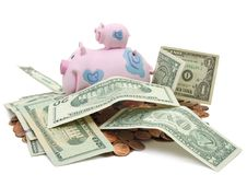 Free Piggy Bank, US Cents And Dollars Royalty Free Stock Photography - 3788917